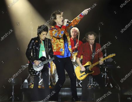 Ronnie Wood, from left, Mick Jagger, Charlie Watts and Keith Richards of The Rolling Stones perform in East Rutherford, N.J. The Rolling Stones are postponing its 15-city North American tour because of the coronavirus. The band announced Tuesday that it's No Filter Tour, originally expected to kick off in San Diego on May 8, will no longer take place