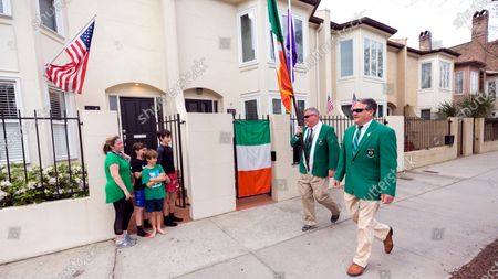 Stock Picture of Sinn Fein Society members Bill Bradley, center, and John Lowenthal, right, walk the St. Patrick's Day parade route in downtown Savannah, Ga, Tuesday, March, 17, 2020. Last week Savannah's mayor announced the city's 196-year-old St. Patrick's Day parade was called off due to coronavirus concerns