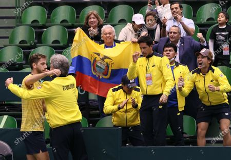Roberto Quiroz (L) of Ecuador celebrates with team captain Raul Viver (2-L) after defeating Yasutaka Uchiyama of Japan at the Davis Cup qualifiers between Japan and Ecuador in Miki, Hyogo Prefecture, western Japan, 06 March 2020.
