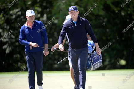 Stock Image of Matt Wallace, right, of England, and Keith Mitchell walk off the first green after making their putts during the third round of the Arnold Palmer Invitational golf tournament, in Orlando, Fla