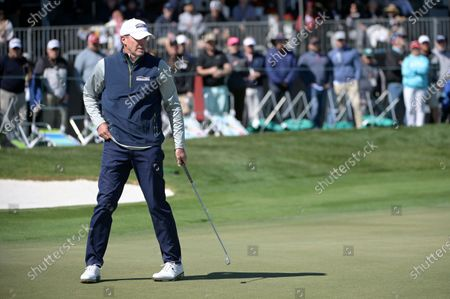 Steve Stricker sets up for his putt on the eighth green during the third round of the Arnold Palmer Invitational golf tournament, in Orlando, Fla