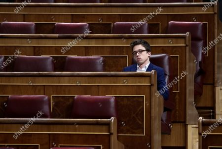 Stock Photo of Spanish left Mas Madrid party's MP Inigo Errejon attends the plenary session to explain the declaration of the 'state of alarm' issued to deal with coronavirus outbreak at Lower Chamber in Madrid, Spain, 18 March 2020. Sanchez delivered a speech on the measures taken to deal with the COVID-19 outbreak. A little representation of MPs attended the session due to restrictions imposed to contain the spread of coronavirus.