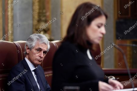 Spanish PM Adolfo Suarez Illana (L) listens to ruling Socialist Party's parliamentary spokeswoman Adriana Lastra (R) during the plenary session focused on the declaration of the 'state of alarm' issued in the country to deal with coronavirus outbreak at Lower Chamber in Madrid, Spain, 18 March 2020. Spanish PM Pedro Sanchez (unseen) explained the measures taken to deal with the COVID-19 outbreak.