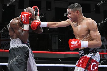 Ahmet Patterson (red/white shorts) defeats Jason Nesbitt in a Welterweight boxing contest at York Hall, Bethnal Green, promoted by Frank Warren
