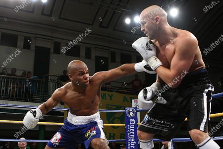 Leon Williams (blue shorts) defeats Rob Norton to win the British Cruiserweight Title at York Hall, Bethnal Green, promoted by Frank Warren