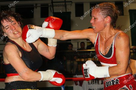 Laura Saperstein (red shorts) defeats Borislava Goranova in a Super-Featherweight boxing contest at York Hall, Bethnal Green, promoted by Left Jab / Miranda Carter