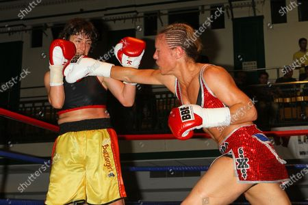 Stock Picture of Laura Saperstein (red shorts) defeats Borislava Goranova in a Super-Featherweight boxing contest at York Hall, Bethnal Green, promoted by Left Jab / Miranda Carter