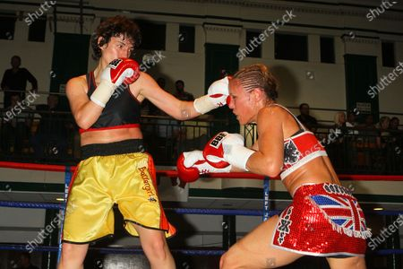 Stock Photo of Laura Saperstein (red shorts) defeats Borislava Goranova in a Super-Featherweight boxing contest at York Hall, Bethnal Green, promoted by Left Jab / Miranda Carter