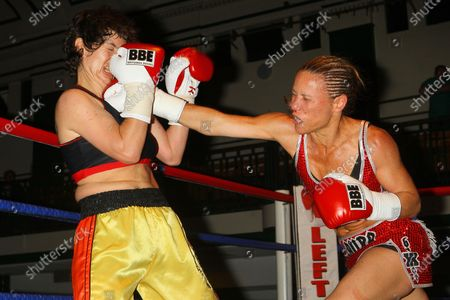 Stock Image of Laura Saperstein (red shorts) defeats Borislava Goranova in a Super-Featherweight boxing contest at York Hall, Bethnal Green, promoted by Left Jab / Miranda Carter