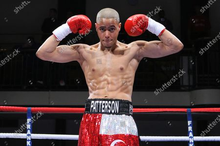 Ahmet Patterson (red/silver shorts) defeats Wayne Downing in a Welterweight boxing contest  at York Hall, Bethnal Green, London, promoted by Frank Warren