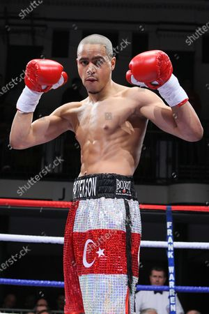 Stock Picture of Ahmet Patterson (red/silver shorts) defeats Wayne Downing in a Welterweight boxing contest  at York Hall, Bethnal Green, London, promoted by Frank Warren