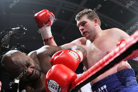 John McDermott (white/blue shorts) defeats Larry Olubamiwo in a Heavyweight boxing contest for the Southern Area Title at York Hall, Bethnal Green, London, promoted by Frank Warren