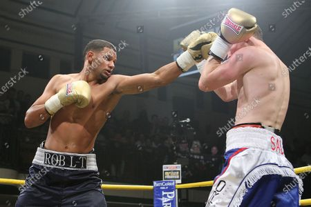 Robert Lloyd Taylor (black/grey shorts) defeats Peter Vaughan (blue/white shorts) in Semi-Final One of Prizefighter The Light-Middleweights II at York Hall, Bethnal Green, promoted by Matchroom Sports