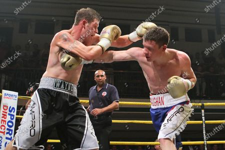 Stock Image of Peter Vaughan (blue/white shorts) defeats Wayne Goddard (grey/black shorts) in Quarter-Final Two of Prizefighter The Light-Middleweights II at York Hall, Bethnal Green, promoted by Matchroom Sports