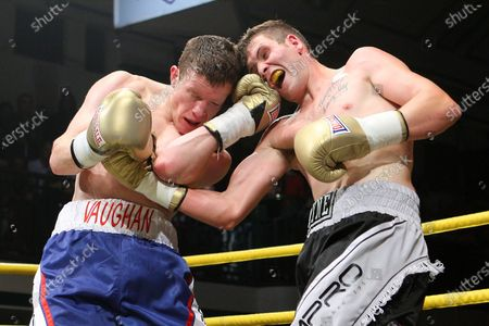 Stock Picture of Peter Vaughan (blue/white shorts) defeats Wayne Goddard (grey/black shorts) in Quarter-Final Two of Prizefighter The Light-Middleweights II at York Hall, Bethnal Green, promoted by Matchroom Sports