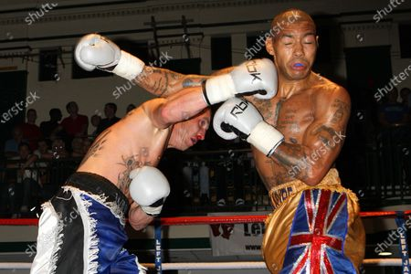 Ashley Theophane (gold/blue shorts) defeats Willie Thompson in a Welterweight boxing contest at York Hall, Bethnal Green, promoted by Left Jab