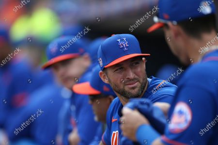 New York Mets' Tim Tebow looks on in the Mets dugout during a spring training baseball game against the Miami Marlins, in Port St. Lucie, Fla. The Marlins won 5-3