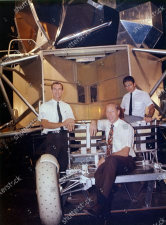 This undated photo made available by NASA shows astronauts Al Worden, center, Dave Scott, left, and Jim Irwin with a moon rover mock-up. Worden, who circled the moon alone in 1971 while his two crewmates tried out the first lunar rover, has died at age 88, his family said