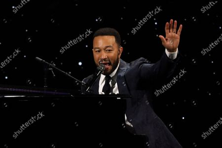 John Legend performing at The Alliance for Children's Rights 28th Annual Dinner in Beverly Hills, Calif. The spreading coronavirus might have canceled several touring performances from A-list musical artists, but those acts have found a new venue to sing: their living rooms. Legend, Bono, Coldplay's Chris Martin, Pink, John Mayer, Keith Urban and more have held virtual concerts from their homes as the world continues to practice social distancing to slow the spread of the virus