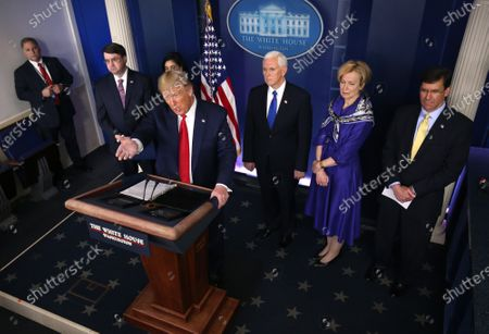 United States President Donald Trump delivers remarks on the COVID-19 (Coronavirus) pandemic alongside members of the Coronavirus Task Force in the Brady Press Briefing Room Standing behind the President, from left to right: US Secretary of Veterans Affairs (VA) Robert Wilkie, US Vice President Mike Pence, Dr. Deborah L. Birx, White House Coronavirus Response Coordinator, and US Secretary of Defense Dr. Mark Esper.