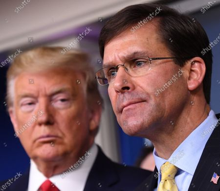 United States Secretary of Defense Dr. Mark Esper delivers remarks on the COVID-19 (Coronavirus) pandemic as US President Donald Trump looks on in the Brady Press Briefing Room at the White House in Washington, DC.