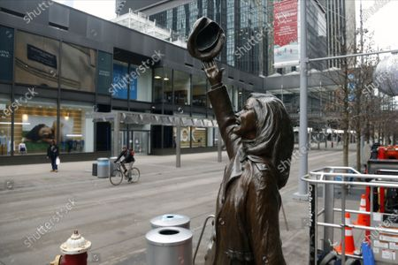 The statue of the late Mary Tyler Moore stands out against an almost deserted Nicollet Mall in downtown Minneapolis . The statue represents the famous hat-tossing in Minneapolis which opened each episode of the television series The Mary Tyler Moore show. As a result of the coronavirus, many retailers are closing or cutting back hours