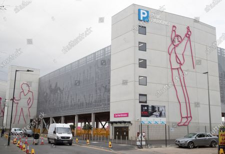 A new car park at Wembley Stadium with outlines of artists that have historically performed including singers Freddie Mercury (right) and Madonna (left)