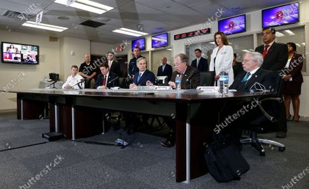 Texas Governor Greg Abbott (C) along with Arlington, Texas Mayor Jeff Williams, Tarrant County Judge Glen Whitley, DSHS Commissioner John Hellerstedt, and TDEM Chief Nim Kidd hold a press conference to discuss new measures after the first confirmed death in Texas, in Arlington, Texas, USA, 18 March 2020. The first confirmed COVID-19 coronavirus death in Texas occurred a day earlier in Arlington.