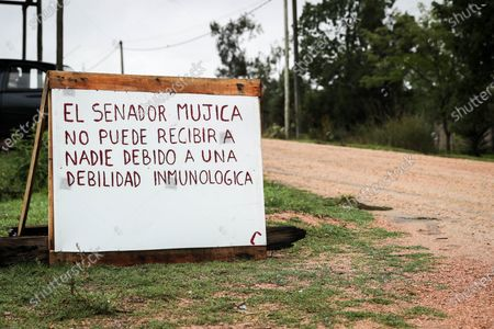 View of a sign that reads 'Senator Mujica cannot receive anyone due to a immune weakness' at his home in Montevideo, Uruguay, 18 March 2020. Senator Jose Mujica and Vice-President Lucia Topolansky decided to comply with the preventive regulations against the coronavirus COVID-19 and locked themselves in their farm (country house) with a sign at the entrance that warns that they cannot receive anyone. Uruguay, which until 17 March had 50 cases of COVID-19 registered, according to the information offered by the Presidency, has been in a 'health emergency' since 13 March.