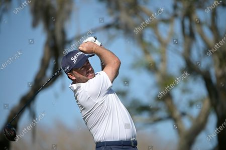 Graeme McDowell, of Northern Ireland, watches his tee shot on the 15th hole during the third round of the Arnold Palmer Invitational golf tournament, in Orlando, Fla