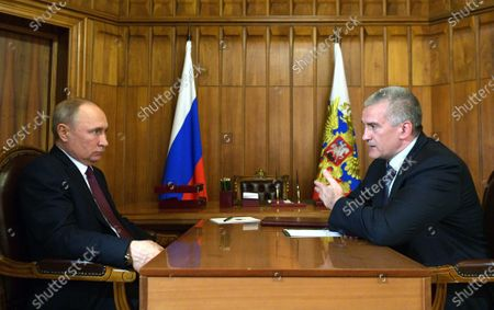 Russian President Vladimir Putin (L) meets with Head of the Republic of Crimea Sergei Aksyonov (R) in Crimea, 19 March 2020.  Vladimir Putin makes a working trip to the Crimean Peninsula.