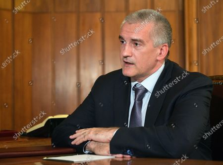 Head of the Republic of Crimea Sergei Aksyonov during a meeting with Russian President Vladimir Putin (not pictured) in Crimea, 19 March 2020.