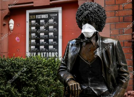 Stock Photo of A view of the statue of Phil Lynott with a mask on as a result of the Coronavirus Epidemic