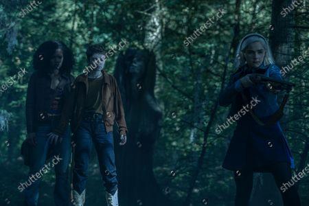 Stock Photo of Jaz Sinclair as Rosalind Walker, Lachlan Watson as Theo Putnam/Susie Putnam and Kiernan Shipka as Sabrina Spellman