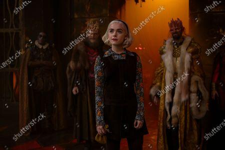 Stock Photo of John Murphy as Asmodeus, Kiernan Shipka as Sabrina Spellman and Nelson Leis as Beelzebub