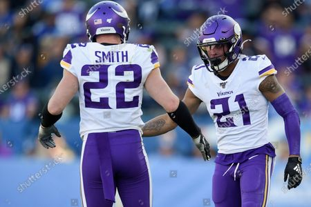 Minnesota Vikings cornerback Mike Hughes, right, celebrates with Harrison Smith during the first half of an NFL football game against the Los Angeles Chargers in Carson, Calif