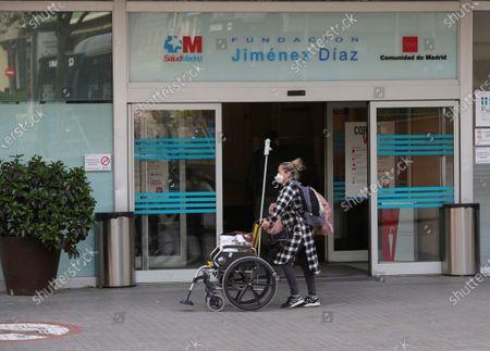 People walk outside the Jimenez Diaz Hospital in Madrid, Spain, 19 March 2020, where allegedly former Madrid Regional President Esperanza Aguirre and husband Fernando Ramirez have checked in for coronavirus.