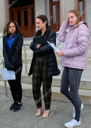 High school track athletes Alanna Smith, left, Selina Soule, center and and Chelsea Mitchell prepare to speak at a news conference outside the Connecticut State Capitol in Hartford, Conn. The three girls have filed a federal lawsuit to block a state policy that allows transgender athletes to compete in girls sports. In a response to their lawsuit, the Connecticut Interscholastic Athletic Conference argued in a court filing that it is not subject to the federal law that guarantees equal access to women and girls in education, including athletics