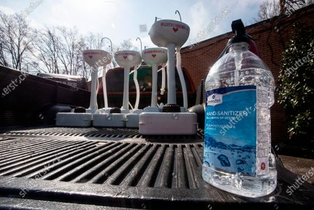 Stock Photo of Hand sanitizer and portable wash stations rest on a truck bed on in College Park, Georgia. The wash stations were distributed by hip hop recording artist Lecrae and volunteers with Love Beyond Walls, a non-profit, throughout Atlanta in areas with a high density of homeless persons