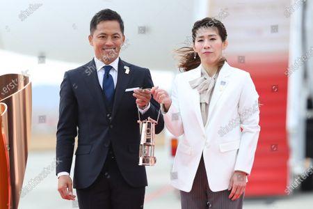 (L-R) Tadahiro Nomura, Saori Yoshida, : Tokyo 2020 Olympic Flame Arrival Ceremony at Matsushima base