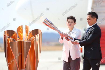 (L-R) Saori Yoshida, Tadahiro Nomura, : Tokyo 2020 Olympic Flame Arrival Ceremony at Matsushima base, Miyagi, Japan.