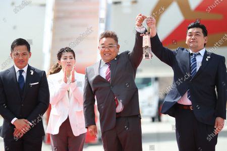 (L-R) Tadahiro Nomura, Saori Yoshida, Mikio Date, Takeshi Tomizawa, : Tokyo 2020 Olympic Flame Arrival Ceremony at Matsushima base, Miyagi, Japan.