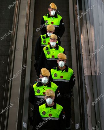 Members of the Spanish Army's Military Emergency Unit (UME) take part in the disinfection of El Prat airport in Barcelona, Catalonia, Spain, 20 March 2020. Spain faces the sixth day of national lockdown in an effort to slow down the spread of the ongoing pandemic of the COVID-19 disease caused by the SARS-CoV-2 coronavirus. According to the latest figures provided by the health ministry, there are at least 19,980 confirmed coronavirus infections throughout Spain, while 1,002 people have died so far in the Mediterranean country.