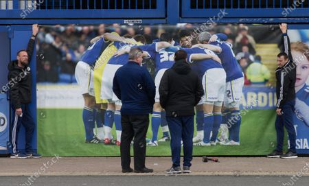 A large banner is put up at Cardiff City Stadium in memory of Cardiff City player Peter Whittingham who tragically passed away earlier this week