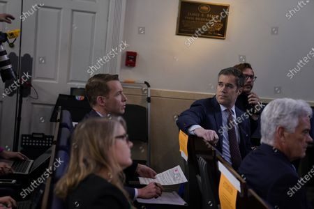 Stock Image of News White House correspondent Peter Alexander, second from right, attends a coronavirus task force briefing at the White House, in Washington