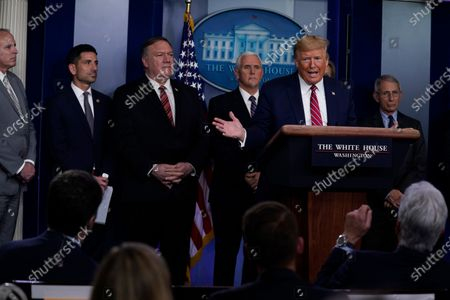 President Donald Trump responds to a question by NBC News White House correspondent Peter Alexander during a coronavirus task force briefing at the White House, in Washington