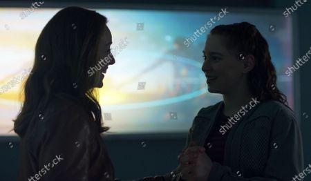 Molly Parker as Maureen Robinson and Mina Sundwall as Penny Robinson