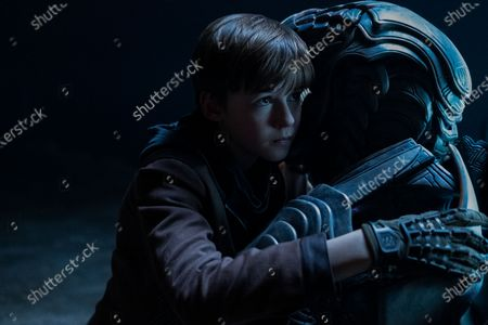 Maxwell Jenkins as Will Robinson and Brian Steele as The Robot