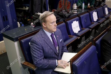 Stock Image of Former White House press secretary Sean Spicer sits in the briefing room of the White House before a Coronavirus Task Force news conference in Washington, D.C., USA, 20 March 2020. Americans will have to practice social distancing for at least several more weeks to mitigate U.S. cases of Covid-19, Anthony S. Fauci of the National Institutes of Health said today. Countries around the world are taking increased measures to stem the widespread of the SARS-CoV-2 coronavirus which causes the Covid-19 disease.