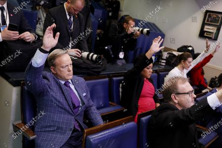 Sean Spicer, former White House press secretary, left, raises his hand to ask a question during a Coronavirus Task Force news conference in the briefing room of the White House in Washington, D.C., USA, 20 March 2020. Americans will have to practice social distancing for at least several more weeks to mitigate US cases of Covid-19, Anthony S. Fauci of the National Institutes of Health said today. Countries around the world are taking increased measures to stem the widespread of the SARS-CoV-2 coronavirus which causes the Covid-19 disease.